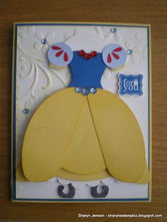 Snow White dress punch art uses various punches and the Oval Framelits dies.