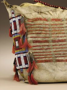 Native American:Textiles, Sioux Tipi Bag. Circa 1875. Length 13 1/2 in. Width 21 1/2 in..This native tanned buffalo hide bag is decorated ac...