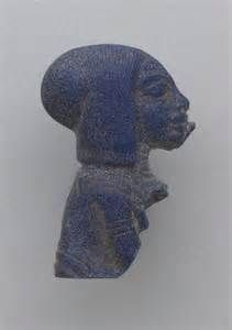 Blue stone carving of a princess of Akhenaten, with a wide, braided sidelock. 18th dynasty.
