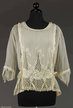 Days Gone By - Late teens to early 1920's white cotton blouse with embroidery and silk fringe.