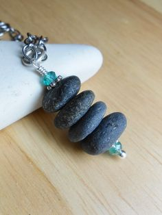 Beach Stone Jewelry, INUKSHUK, Stacked Cairn Beachstone Necklace. $26.00, via Etsy. Rock Jewelry, Leather Jewelry, Stone Jewelry, Beaded Jewelry, Seashell Jewelry, Sea Glass Jewelry, Beach Stones, Beach Rocks, Love Necklace