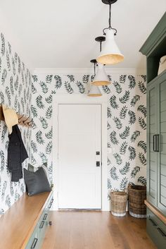 Mudroom design ideas with green cabinets and large print wallpaper