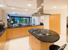 Beautiful Oval Kitchen Island With Black Countertop Kitchen Lighting Wood Cabinet  Furniture