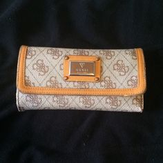 USED Guess wallet This was my wallet for 2 years and it has held up really well. Plenty of room for tons of cards and cash. There is wearing on the sides from use, see pictures. Guess Bags Wallets