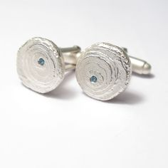 Silver etched cufflinks set with aquamarines.
