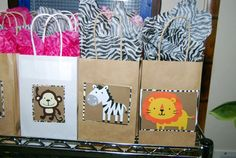 Safari themed party decorations - gift bags & cupcake skewers Jungle Party Favors, Jungle Theme Parties, Safari Theme Party, Safari Birthday Party, Baby 1st Birthday, Party Favor Bags, 1st Birthday Parties, Birthday Hats, Birthday Box
