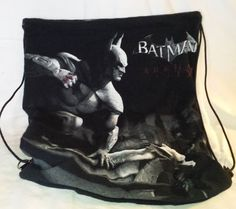 Handmade by me, up-cycled vintage t-shirt draw string back pack.  BATMAN t-shirt that has been up cycled and lined.  Batman movie t shirt that has been up cycled.  READY TO SHIP today.  T-shirts are hand picked, washed, and up-cycled into a unique draw string back pack.  They are lined for durability, parachute cord for the draw string closure and double sewn seams.  Measures 14 3/4 wide and 17 1/2  tall.  Washable and dry able on low heat, durable and strong.  Any questions please...