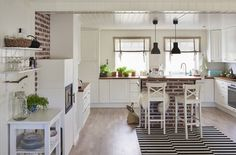 Gina's spacious, but cozy open-plan kitchen and dining area radiates warmth