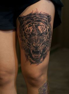 Chronic Ink Tattoo - Toronto Tattoo Tiger tattoo on the thigh, done by Marilyn.