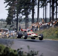 "Graham Hill in his Lotus 49 jumps at the ""Brünnchen"""