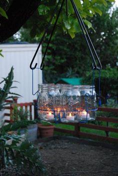MASON JARS :: Multi Jar Chandelier :: Made from canning jars & a canning basket! Mason Jar Chandelier, Outdoor Chandelier, Mason Jar Lighting, Outdoor Lighting, Outdoor Decor, Simple Chandelier, Outdoor Ideas, Outdoor Spaces, Ball Jar Lights