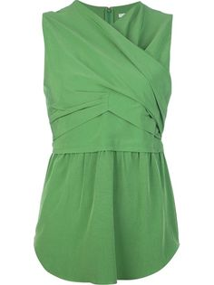 Green sleeveless blouse from Carven featuring as cross over front detail, nipped in waist, rear zip fastening and a curved hem.