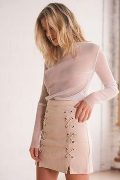 The type of stitched up you'll want to be. This skirt comes in sweet pink and sultry black... we recommend getting both because you never know what mood you'll be in. Material: Suede, Faux Leather