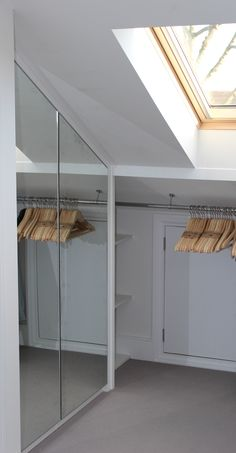 Bespoke made to measure loft wardrobe with mirrored doors. #BespokeFurniture made in London www.timamery.com Loft Room, Bedroom Loft, Loft Closet, Loft Bathroom, Master Bedroom, Slanted Ceiling Closet, Sloped Ceiling Bedroom, Slanted Walls, Wardrobe With Mirror