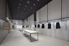 Nendo designed in Los Angeles the interiors of two shops for Theory, combining simplicity and functionality with New York loft-style materials and focusing on the flow of people.