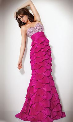 Floor length strapless sweetheart mermaid dress with sequin detail on bust, empire waist, and pleated skirt.