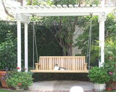 Or maybe this pergola for the yard painted grey green or weather to a gray. Wood chips underneath and vines growing up the support poles