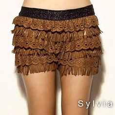 Camel suede fringed cake divided skirts is what is says, but I believe they are shorts