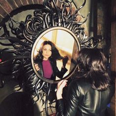 Awesome Regina looking at herself in her awesome magic mirror possibly in her awesome vault in an awesome S4 episode of Once