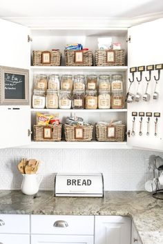 Pantry Cabinet Organization and Printable Labels A cabinet gets a drastic organization makeover using inexpensive IKEA jars / baskets, hanging storage, and a free pantry label printable set.