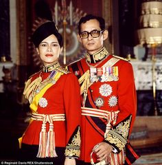 The Thai king and queen in Guards uniform in the Throne Room of the Grand Palace, Bangkok. There will now be a year-long mourning period in Thailand