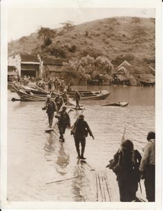 Japanese army advancing toward the city of Matung during the invasion of China, dated 07-20-1938.