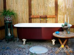 Outdoor bathtub with natural Cali Bamboo fencing