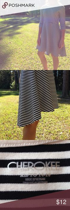 Girls XL/TG 14-16 Cherokee brand high low dress -Black and white horizontal striped -high low dress.                                                              Heavy weight. Mid sleeves. White neck line. Worn before Cherokee Dresses Casual