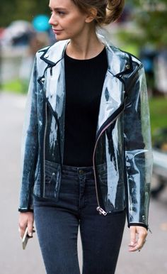 Clear vinyl rain jacket with black trim and zipper closure worn over black top and grey-wash pants.. DIY the look yourself: http://mjtrends.com/pins.php?name=clear-vinyl-for-jacket_5