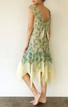 Interesting treatment in back and the hemline is innovative and fun.
