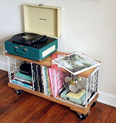 Industrial look metal milk crates converted into this nifty storage on lockable castors. Add a few box cushions and this could double as a moveable seat for when there are extra guests...
