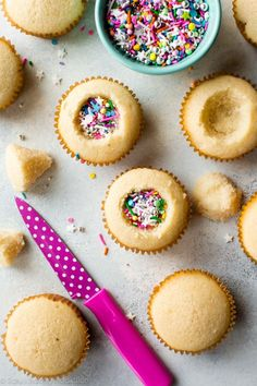 How to make party piñata cupcakes filled with sprinkles! Easy to make and ready for any celebration. We love these for a girl's birthday party!