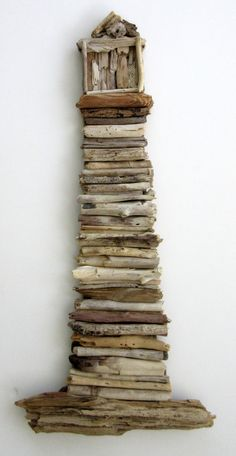 This beautiful driftwood lighthouse is made of natural driftwood found on the beaches of South Florida. Each piece of driftwood is hand selected.plus I see the princess and the pea for some reason Awesome Woodworking Ideas, Woodworking For Kids, Woodworking Clamps, Driftwood Projects, Driftwood Art, Diy Projects, Nautical Wall Decor, Nautical Home, Lighthouse Decor
