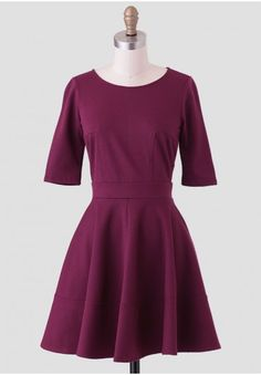 <p>Perfect for a semi-formal occasion, this stunning deep burgundy dress is perfected with a fit-and-flare silhouette in a soft fabric with plenty of stretch. Complete with a three-quarter length sleeve and a hidden back zipper closure, this elegant dress can be paired with T-strap heels and an up-do for a sophisticated ensemble. Unlined, opaque.</p><p>96% Polyester, 4% Spandex<br /> Made In USA<br /> 29