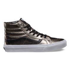 The Metallic Leather Sk8-Hi Slim, a slimmed down version of its original, is lace-up high top with a durable metallic leather upper, a supportive and padded ankle and Vans vulcanized signature Waffle Outsole.