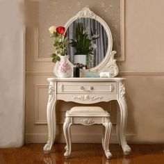 Furnishings: This Parisian vantity is a beautiful cream color with curved legs and carved wood. The shape is very curvy and elegant. Parisian furnishings are very elegant and detailed. Casas Shabby Chic, Shabby Chic Mode, Shabby Chic Style, Parisian Style, Diy Vanity, Wood Vanity, Vanity Set, Parisian Bedroom, Shabby Chic Bedrooms