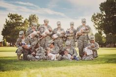 """Striking Photo of Breastfeeding Soldiers Stirs Debate. To all of that, adds one commenter: """"Men can smoke, drink, dip, have tattoos, go to the mall, clubs and restaurants in uniform AND remove their top, but a woman DARES FEED her child and OMG CONTROVERSY."""""""