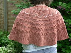 Cables & lace decorate this sideways knitted wrap, shaped with short rows.