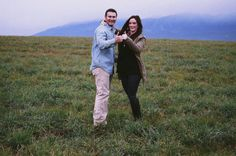 Reenact the proposal! Dorks. Whitefish, Montana Romantic Engagement Photo in the Field, Big Mountain in the Background.