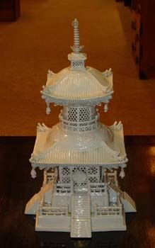 A porcelain pagoda could settle into my tablescape among the flower brooches. Ive seen modern music box versions, and also teapot versions. The teapot kind could do double duty as a vase. This picture is of an authentic Japanese porcelain pagoda tower that apparently sold on eBay for US850.