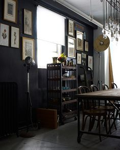 dark walls + dark wood + rustic