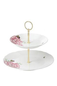 This white porcelain 2-tier cake stand is detailed with Miranda's favourite peonies and butterflies and finished with a gold centrepiece. Just add macaroons and delicious cupcakes! #MirandaKerr #RoyalAlbert #MirandaKerrRoyalAlbert