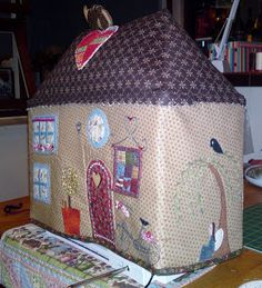 I made this little house for my sewing machine to live in when I am not using it!! I had so much fun, creating every single element. And...