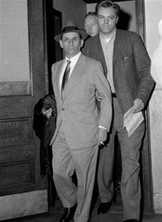 Meyer Lansky, Vegas mobster, left, is escorted by New York City detectives,  following his arrest, February 11, 1958 file photo / AP