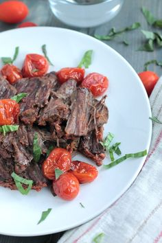 This paleo, Whole30 compliant A1 Inspired Slow Cooker Beef Roast with blistered tomatoes is a family favorite. Packed with flavor and protein!