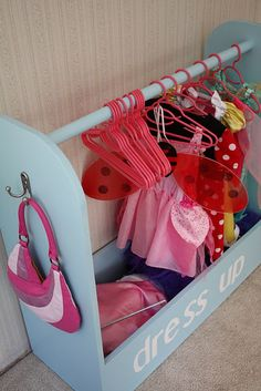 Idea to organize the toy box full of dress up stuff!!  Is it bad that I have started Mackenzie's dress up wardrobe already?