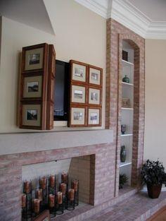 Traditional Home hide tv over fireplace Design Ideas, Pictures, Remodel and Decor Tv Emoldurada, Tv Escondida, Deco Tv, Tv Above Fireplace, Unused Fireplace, Black Fireplace, Fireplace Hearth, Modern Fireplace, Hidden Tv