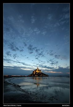 Mont Saint Michel on 14th of July.   Thanks for all the nice comments. Because i have no Pro Account i can not post it bigger. You can find a bigger version on my homepage: blog.lord-lance.com  Thanks for all the feedback! Great!