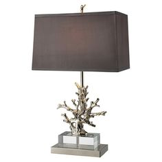 Brass and crystal table lamp with a coral-inspired base. Product: Table lamp Construction Material: Brass, fabric and ...$250