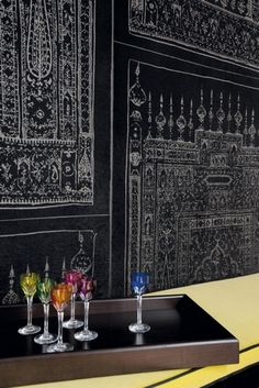 #Wallpaper and colored wine glasses by Elitis
